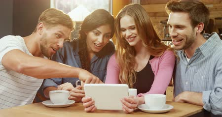 socialization : Group of friends using digital tablet in cafe 4k Stock Footage