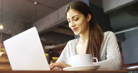 drink shop : Young woman using laptop in cafe 4k Stock Footage