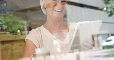 drinking coffee : Happy senior woman using digital tablet in cafe 4k Stock Footage