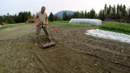 ploughing : Mature man using agricultural equipment in the farm 4k Stock Footage