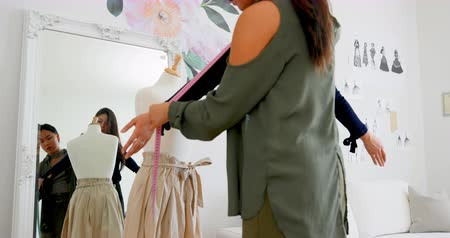 dressmakers model : Fashion designer measuring the lengths of a customer at design studio 4k