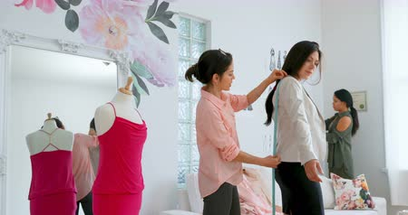 dressmakers model : Fashion designers measuring the the size of customer at design studio 4k Stock Footage