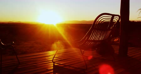 absence : Chair in the porch at farmhouse during sunrise 4k Stock Footage