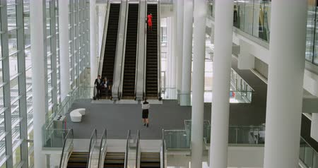 escalators : Business woman using escalator at office 4k Stock Footage