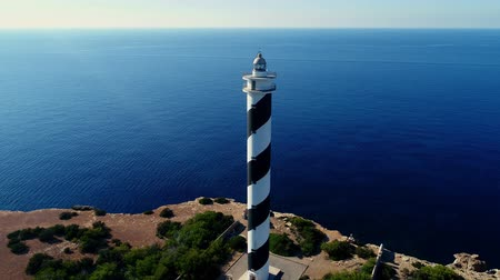 absence : Aerial view Lighthouse surrounded by sea 4k Stock Footage