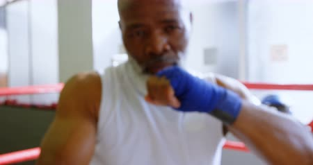 cross training : Mid section of senior man boxing in the fitness studio 4k Stock Footage