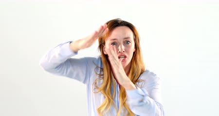 bastante : Portrait of frustrated woman standing against white background 4k