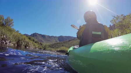 kayak : Woman kayaking in lake at countryside at sunny day 4k Stock Footage