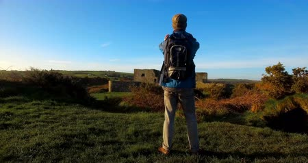 fortress : Rear view of male hiker hiking in countryside 4k Stock Footage