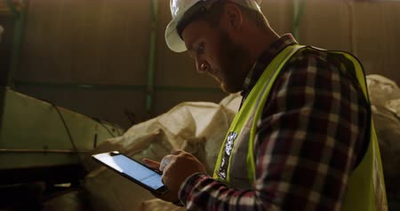 discard : Male worker using digital tablet in warehouse 4k Stock Footage