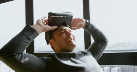 personal computers : Male executive removing virtual reality headset in office 4k