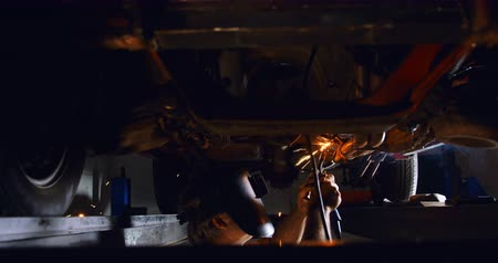 welding helmet : Male mechanic using flaming torch in garage 4k