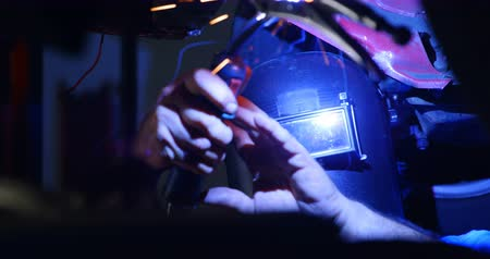 welding helmet : Close-up of male mechanic using flaming torch in garage 4k