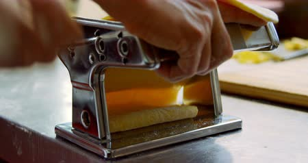 pasta cutter : Close-up of baker using pasta cutter in bakery shop 4k Stock Footage