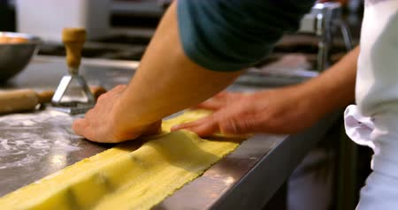mid section : Male baker preparing pasta in bakery shop 4k Stock Footage