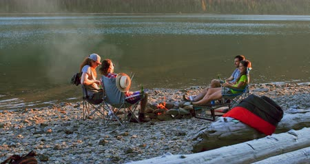 bonfire : Group of hikers camping near riverside at countryside 4k Stock Footage