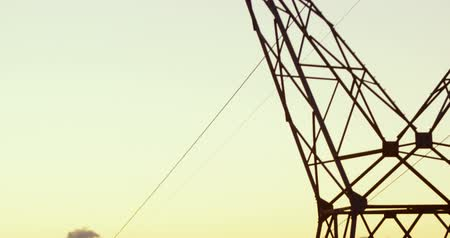 powerline : Low angle view of high voltage electric pole during sunset 4K 4k
