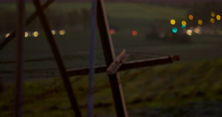powerline : Frame of electricity pylon against the bokeh vehicle lights at sunset 4K 4k