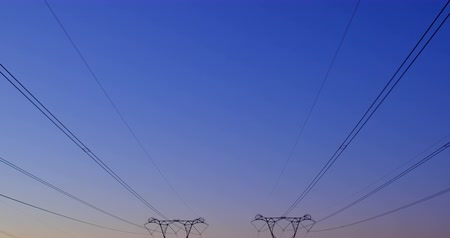 powerline : High voltage electric poles during sunset 4K Stock Footage