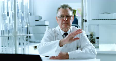 assumption : Male scientist using invisible screen in laboratory 4k Stock Footage