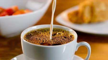 fincan tabağı : Close-up of pouring milk into a cup of coffee 4k