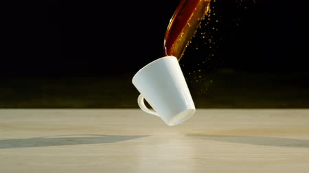 spilling : Coffee spilling on white floor 4k Stock Footage