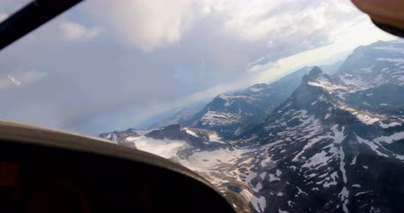 temprature : Private aircraft flying over snowcovered mountain 4k