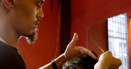 barber hair cut : Close-up of barber trimming clients hair at barber shop 4k Stock Footage