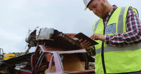 discard : Attentive male worker using digital tablet in the junkyard 4k Stock Footage