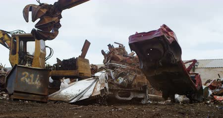 discard : Modern excavator machine being operated in the junkyard 4k Stock Footage