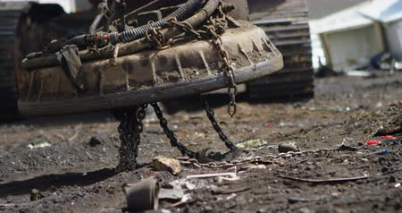 discard : Close-up of excavator machine being operated in the junkyard 4k