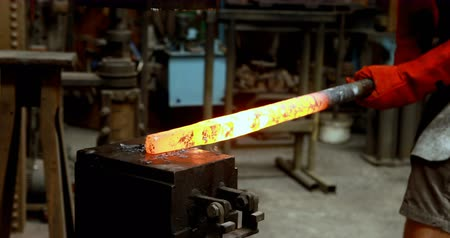 hot rod : Blacksmith shaping hot metal rod in machine at workshop 4k