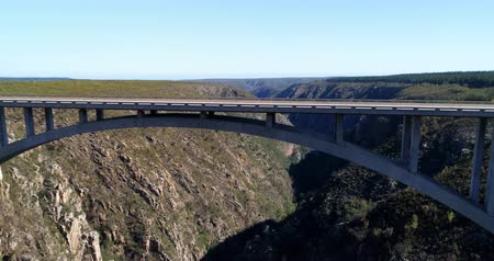 cape town : Aerial of vehicles moving on the bridge between the mountains 4k Stock Footage