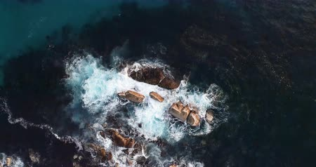 cape town : Aerial of waves splashing o the rocks amidst the sea 4k Stock Footage