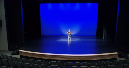 rehearsing : Male guitarist performing on the stage 4k