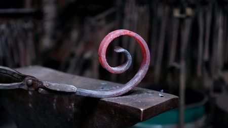 shaping : Blacksmith shaping the molten metal with hammer in workshop 4k