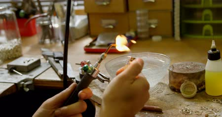 craftswoman : Jewelry designer working with wielding torch in workshop 4k Stock Footage