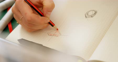 mid section : Close-up of jewelry designer sketching on white paper 4k Stock Footage