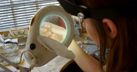 magnifier : Close-up of female jewelry designer working in workshop 4k Stock Footage