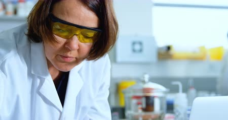 soldering iron : Attentive female scientist experimenting in laboratory 4k