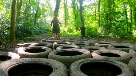 recruter : Fit mens training over tyres obstacle course at boot camp 4k