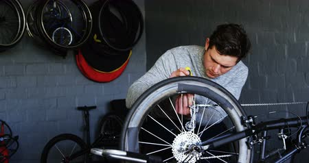 physically : Young disabled man repairing wheelchair at workshop 4k Stock Footage