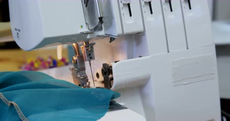 absence : Close-up of sewing machine in fashion studio 4k