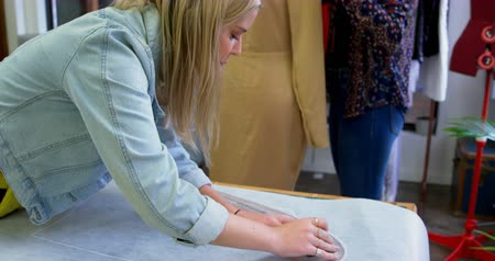 dressmakers model : Fashion designers working on table in fashion studio 4k Stock Footage