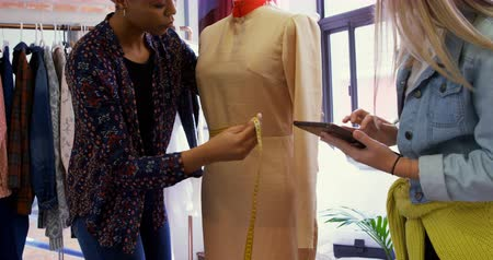dressmakers model : Fashion designers measuring dress on dressmakers model in fashion studio 4k Stock Footage