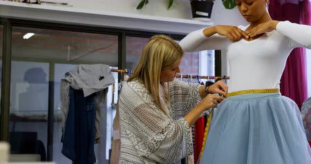 female measurements : Fashion designer taking measurement of customer in fashion studio 4k Stock Footage