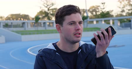 physically : Disabled athletic talking on mobile phone at sports venue 4k