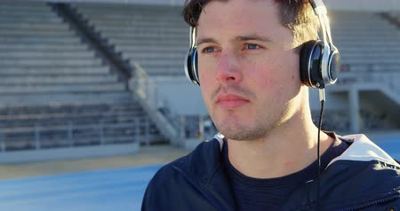 physically : Close-up of disabled athletic listening music at sports venue 4k
