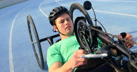 high speed track : Disabled athlete racing in wheelchair on a racing track 4k Stock Footage