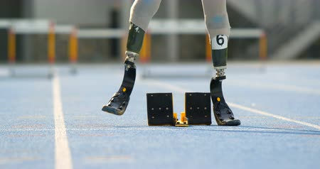 physically : Disabled athletic getting ready for the race on a running track 4k